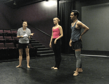 Facilitator Suzanne Haag and dancers Antonio Anacan and Victoria Harvey discuss an audience member's suggested movement.