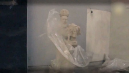 "Video still, ""2000 year old sculpture alerts world to its demise""/Ryan Woodring"
