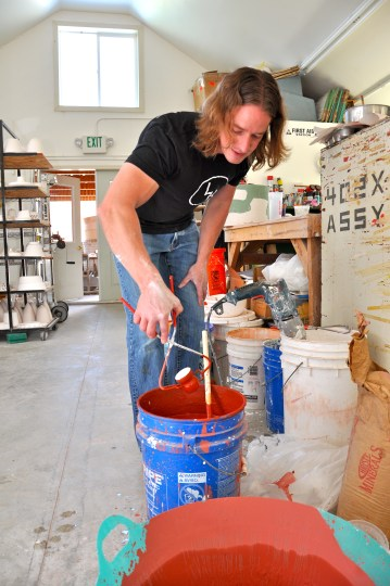 Mixing glazes and then dipping a piece.
