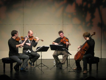 Friends of Chamber Music brings back to Portland the Calder Quartet, which performed in outreach programs like this one during their last FOCM appearance. Photo: courtesy of Friends of Chamber Music.