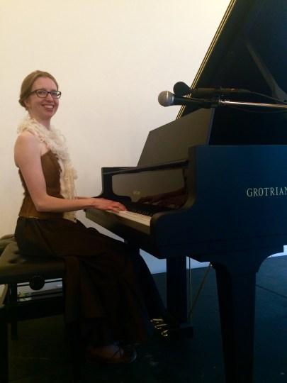 Elbows in: Christina Kobb demonstrates 19th century piano posture. Photo: