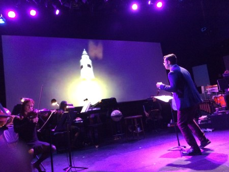 """Tylor Neist conducts Bridgetown Orchestra in 'The Overview Effect."""""""