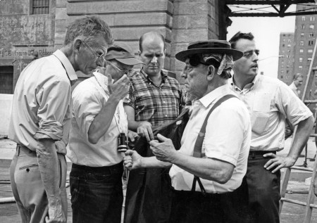 By the Brooklyn Bridge, shooting a scene from FILM BY SAMUEL BECKETT taken in the summer of 1964. Beckett is seen on the far left in his only trip to America, specifically to shoot the film. Director Alan Schneider is wearing the baseball cap and glasses and Buster Keaton is wearing his porkpie hat.