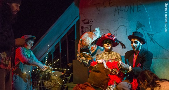 """Themes of celebration and mortality share the stage as two """"dead"""" characters entertain the living. L to R: Geo Alva, Carrie Anne Huneycutt, Carlos Manzano, Patricia Alvítez, Juliet Maya Buri and Robi Arce"""