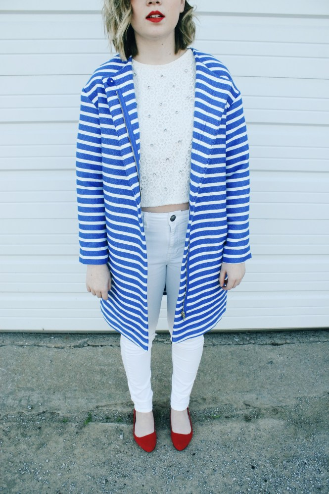 Close up image of outfit. featuring a striped statement jacket