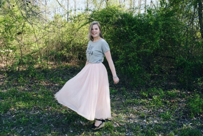 "Pink Skirt. Modeling a ""Live Simply"" graphic tee, pink ballerina skirt, and lace up wedges."