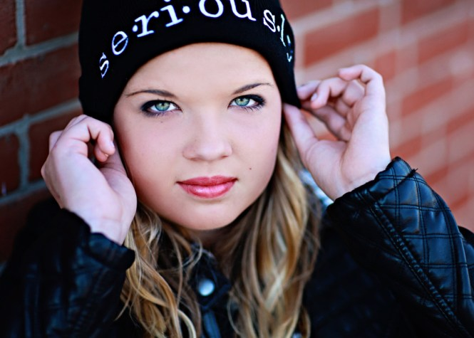 Senior Pictures: Style Guide. Close up image of my face wearing a beanie.