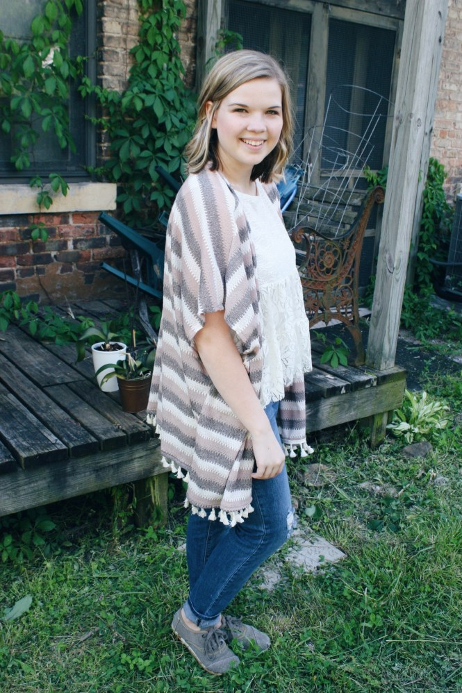 Mix & Match. Modeling a striped poncho, a lace tank top, boyfriend jeans, and corduroy Toms.