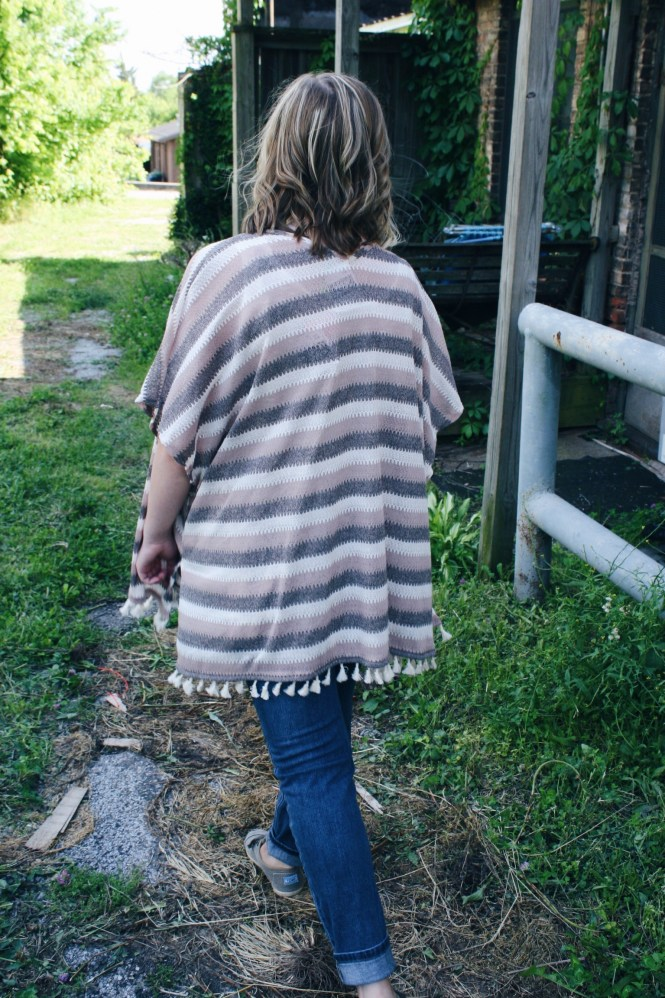 Mix & Match. Modeling a striped poncho, boyfriend jeans, and corduroy Toms.