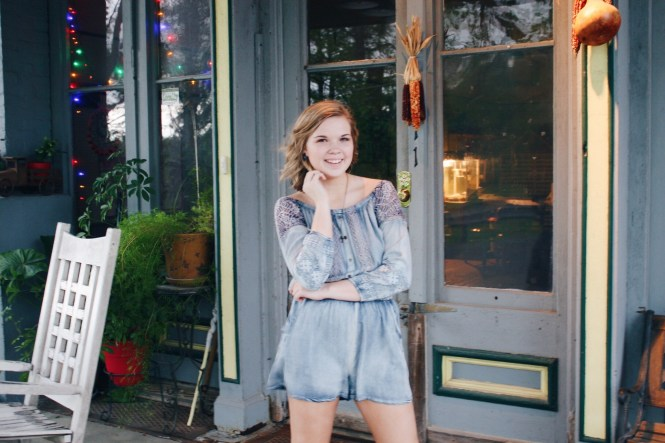 You Can't Go Wrong With Denim. Modeling a denim romper and a priceless necklace.
