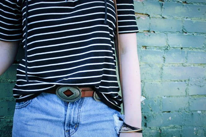 Celebrity Inspired Clearance Rack Finds. Close up of the denim, belt, purse, and stripes.