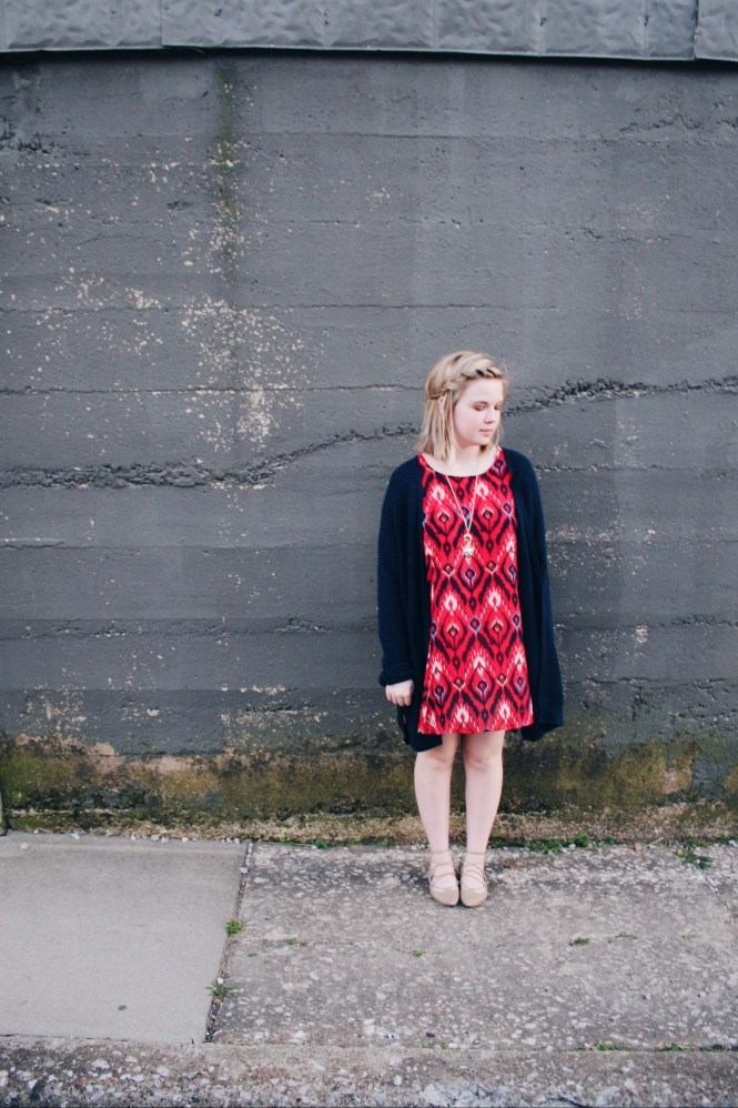Tone It Down. Modeling a printed dress, over sized cardigan, lace up flats, and fox necklace.
