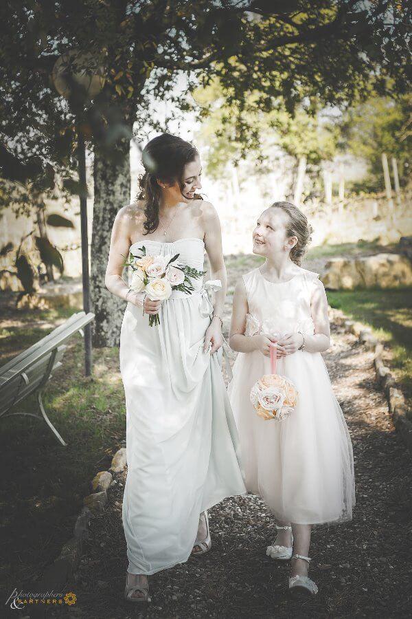 Bridesmaid and baby reach the bride
