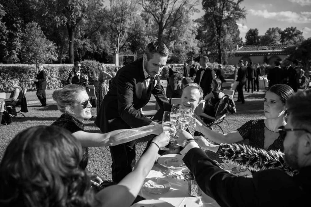 The groom have a toast with the guest after the wedding