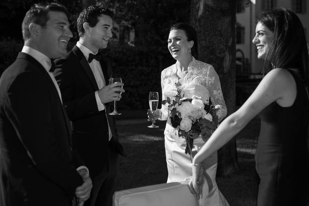 The bride have a toast with the guest after the wedding