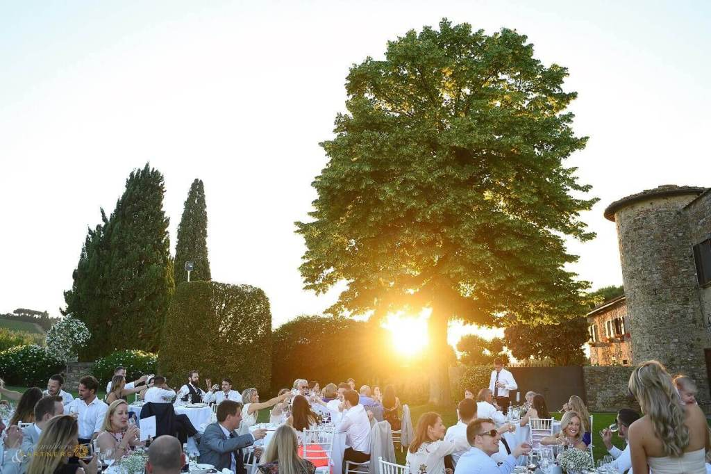 The newlyweds and their guests enjoy al fresco dinner