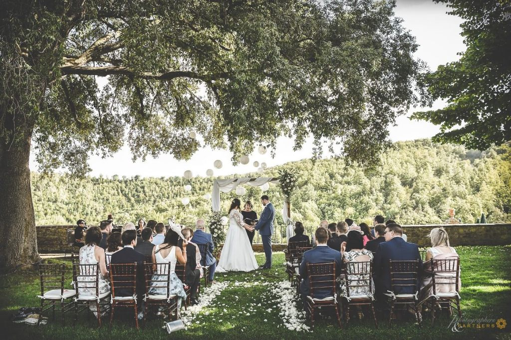 Bride and groom hold hands at wedding ceremony