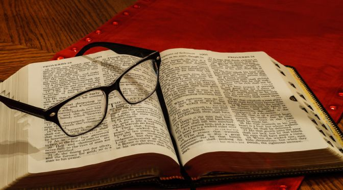 50499084 - glasses on open study bible