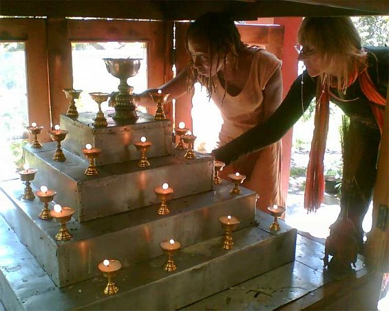 Lighting butter lamps for Disha's puja