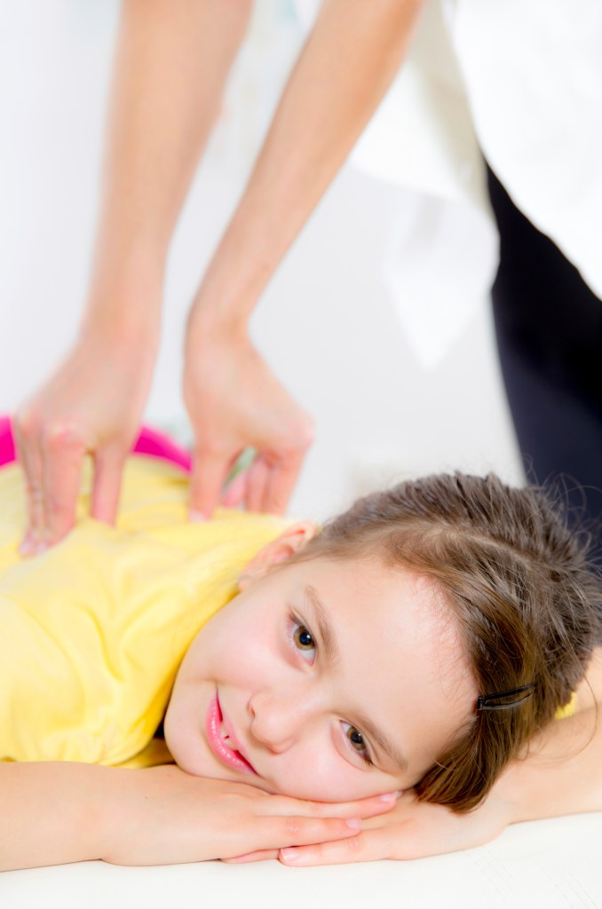 Chiropractic Doctor Adjusts Elementary Girl