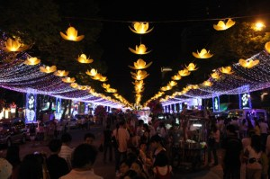Vietnamese stroll the decorated streets