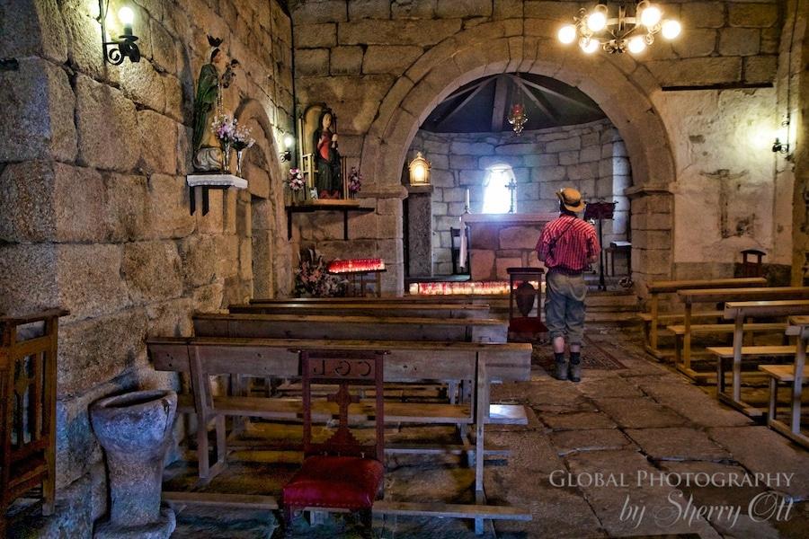 camino pilgrim in church