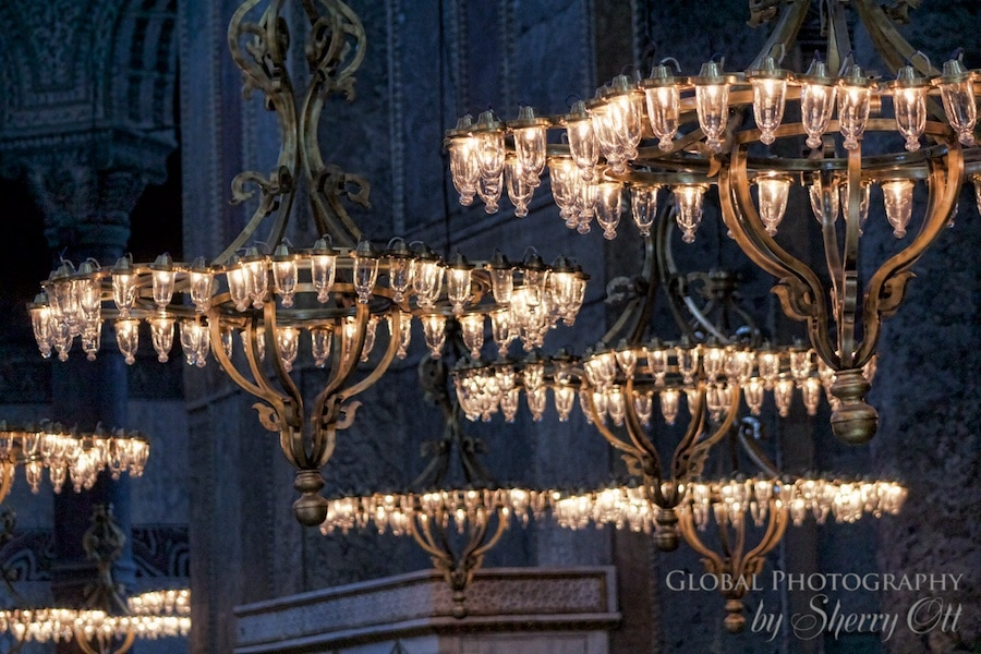 Lights hang from the tall ceiling of Hagia Sophia