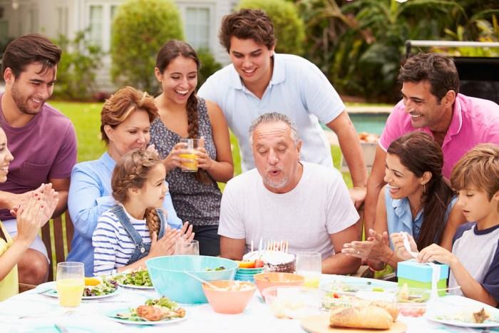 Multi Generation Family Celebrating Birthday In Garden
