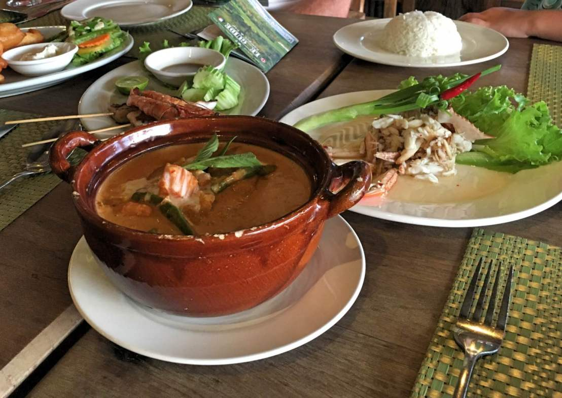 Khmer curry at the front, crab salad to the right and seafood skewers to the left