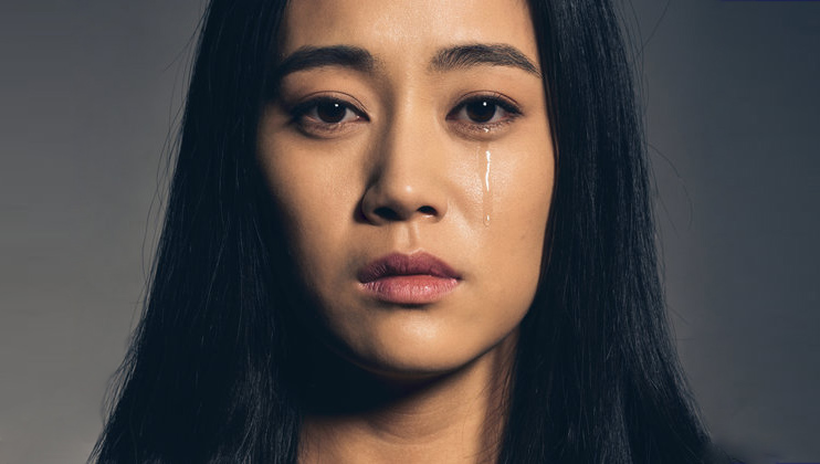 Portrait of Chinese young woman crying.