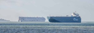 UECC AUTOSTAR passing the Hoegh Osaka in the Solent