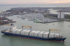 Container ship arriving at Portsmouth Harbour with Gosport in the background