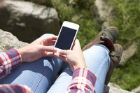 Teenage Girl Using Mobile Phone In Countryside