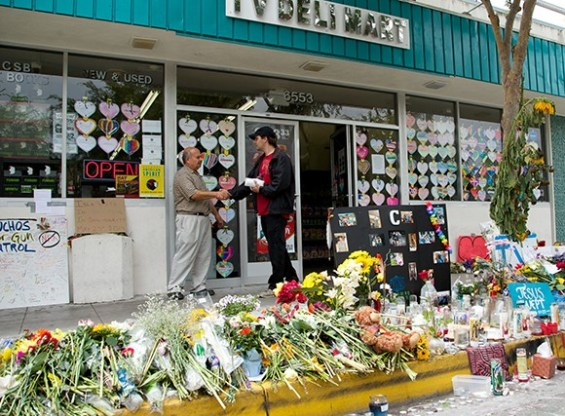 IV Deli Mart owner Sam Hassan, left, welcomes a customer to his popular Isla Vista store, which has become a memorial and gathering place since the May 23 massacre. (Business Times photo)