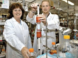 Amgen scientists Nessa Hawkins, left, and Robert Kurzeja pose in the company's lab in Thousand Oaks. (Bloomberg News file photo)