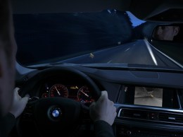The night-vision system produced by Autoliv in Goleta highlighted in BMW promotional materials. The automakers cars alert drivers of nearby pedestrians and animals in four ways: an infrared display, the intstrument panel, the heads-up display and a spotlight. (Photo courtesy Autoliv)