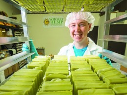 Robert Lestak, owner of Wholly Hemp, stacks fresh bars of soap. (Nik Blaskovich / Business Times photo)