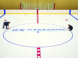 Matt Dugan and  Sean Ward place the lines and logos during the icing process at the new Ice In Paradise.