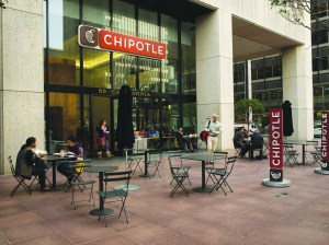 Customers dine outside at a Chipotle Mexican Grill.