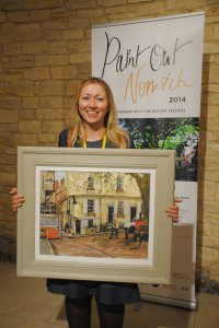 Haidee-Jo Summers (1st Prize) with her winning painting - Work to be Done