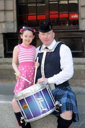 Pic four: John McDougall of Johnstone pipe band with daughter Ellie, six.