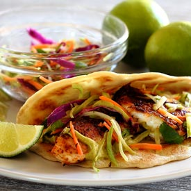 Paleo Spicy Tilapia Baja Taco with Lime Slaw and Avocado Cilantro Sauce