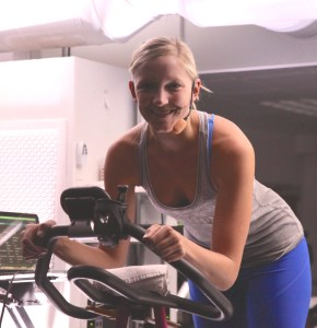 uforia Revolutions instructor in the cycling studio. Photo by Palo Alto Pulse.