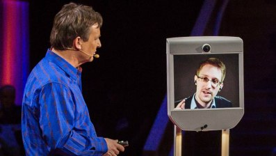 Chris Anderson interviews Edward Snowden via Beam at TED 2014. Photo credit: robohub