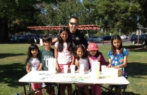 Palo Alto Police officers visiting kids for the #copslovelemonadestands campaign