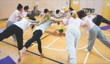 AYP girls doing yoga together