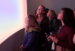 visitors at Pace Gallery's new location in Palo Alto wonder at James Turrell's work