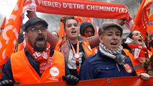 Railway workers and protestors attend a demonstration during a national day of strike against reforms in Paris, France, March 22, 2018.  REUTERS/Charles Platiau