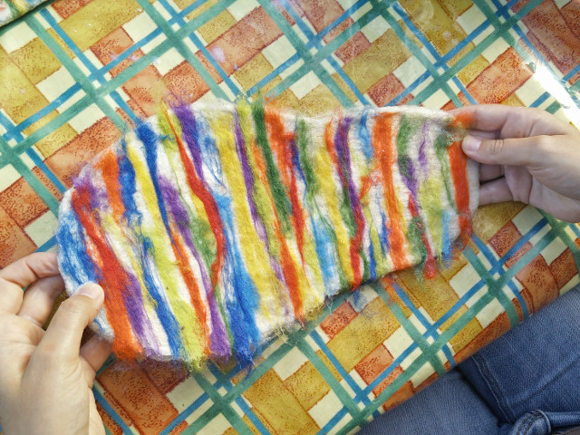Hand felted slippers: The final layer of coloured wool