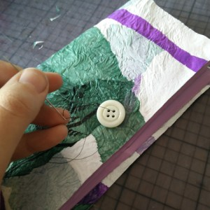 Sewing the button onto the wallet